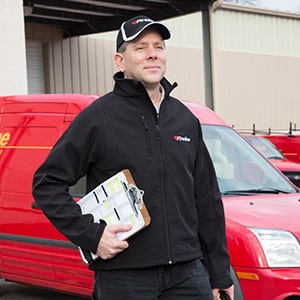 Fireline Technician in Front of Company Service Truck
